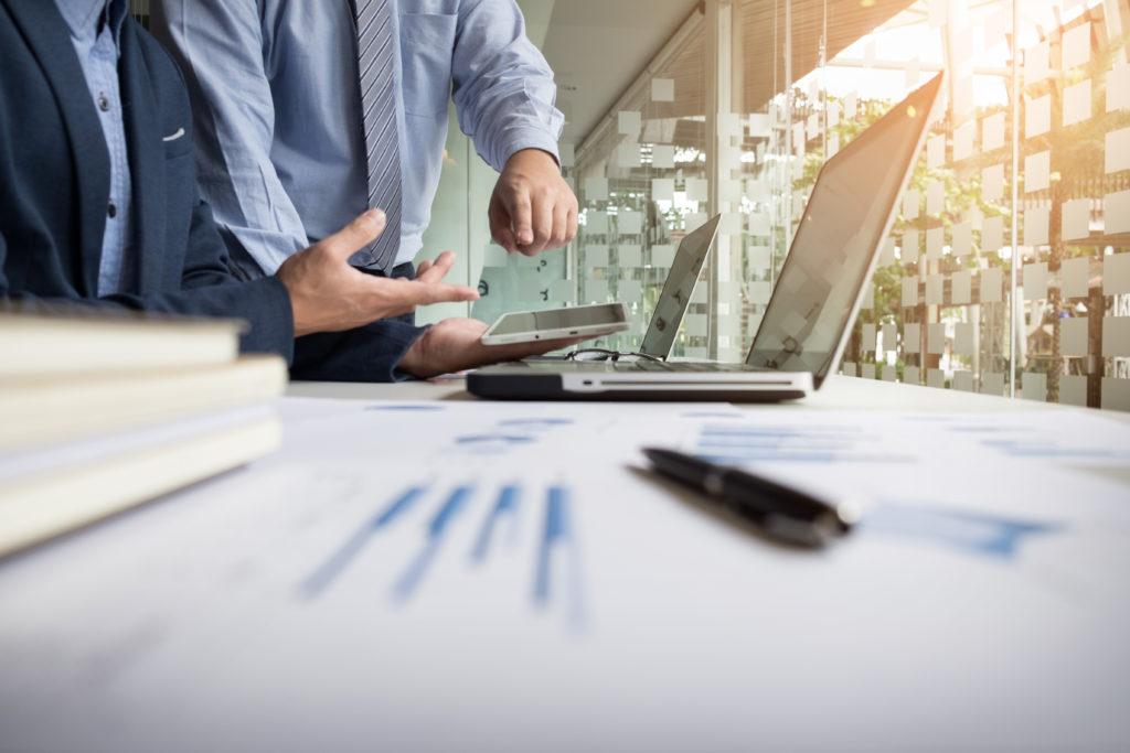 Commercial advisor analyzing financial figures denoting eforsair progress